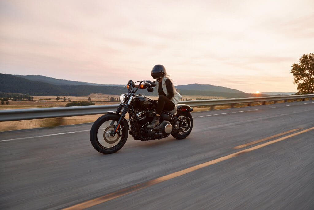 person riding motorcycle at sunset